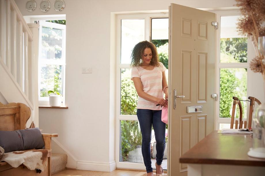 woman walking in door